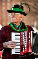 An accordion player entertains the crowds who turned out to watch the annual St. Patrick's Day Parade in Uptown/Downtown Charlotte, North Carolina. (Model Released)