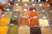 Sao Paulo, Brazil. Market display of spices, peppers and herbs in plastic containers.