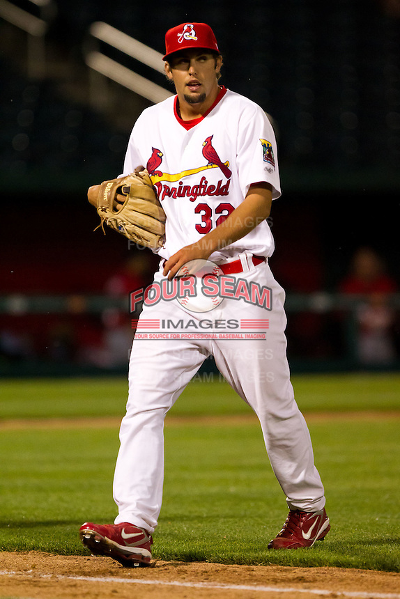 Nick Greenwood (32) of the Springfield Cardinals walks back to the dugout after the eighth inning during a game against the Frisco RoughRiders on April 14, 2011 at Hammons Field in Springfield, Missouri.  Photo By David Welker/Four Seam Images.