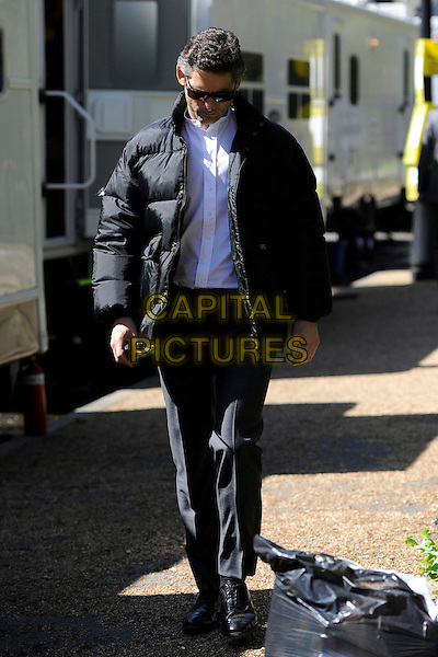 "Eric Bana leaving the base camp at Lincoln's Inn, where he is filming a movie ""Closed"" London , England..30th April, 2012.**EXCLUSIVE ALL-ROUNDER**.full length black trousers puffa jacket white shirt sunglasses shades looking down.CAP/IA.©Ian Allis/Capital Pictures."