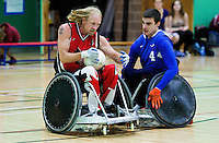 15 AUG 2011 - LEEDS, GBR - Canada's Garett Hickling brushes off a challenge from Great Britain's David Anthony during the wheelchair rugby exhibition match between the two teams .(PHOTO (C) NIGEL FARROW)