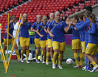 Women's Olympic Football match France v Sweden on 3.8.12...Close team spirit with the Swedish team before the Women's Olympic Football match between France v Sweden at Hampden Park, Glasgow...............
