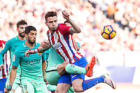 Saul Iniguez competes for the ball with Luis Suarez and Sergio Busquets of Futbol Club Barcelona  during the match of Spanish La Liga between Atletico de Madrid and Futbol Club Barcelona at Vicente Calderon Stadium in Madrid, Spain. February 26, 2017. (ALTERPHOTOS) /NortEPhoto.com