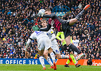Leeds United's Tyler Roberts challenges Sheffield United's Dean Henderson in the air<br /> <br /> Photographer Alex Dodd/CameraSport<br /> <br /> The EFL Sky Bet Championship - Leeds United v Sheffield United - Saturday 16th March 2019 - Elland Road - Leeds<br /> <br /> World Copyright © 2019 CameraSport. All rights reserved. 43 Linden Ave. Countesthorpe. Leicester. England. LE8 5PG - Tel: +44 (0) 116 277 4147 - admin@camerasport.com - www.camerasport.com