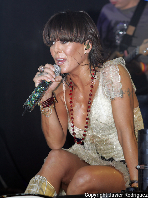"Mexican singer Alejandra Guzman sings a song of her new album ""Indeleble"" (Indelible) during a concert at the Mexico City's Hard Rock Cafe, March 30, 2006. Photo by © Javier Rodriguez"