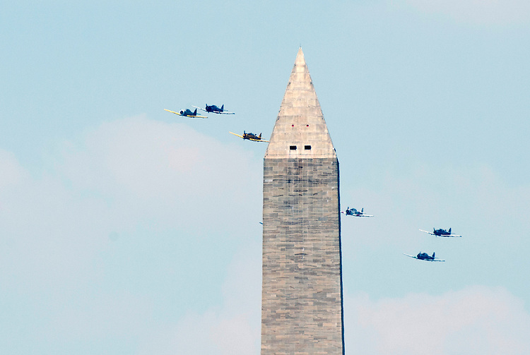 WASHINGTON, DC - MAY 8: World War II era planes fly past the Washington Monument as they fly down the National Mall during the Arsenal of Democracy Flyover  the 70th anniversary Victory in Europe celebration on Friday, May 8, 2015. (Photo By Bill Clark/CQ Roll Call)