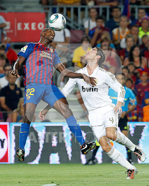 FC Barcelona's Eric Abidal (l) and Real Madrid's Sergio Ramos during Spanish Supercup 2nd match.August 17,2011. (ALTERPHOTOS/Acero)
