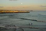 surfers at dusk at Cowell's Beach, Santa Cruz, CA.