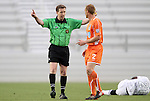 28 April 2012: Referee Andrew Chapin warns Carolina's Greg Shields (SCO) (2) after a foul on San Antonio's Walter Ramirez (HON) (21). The San Antonio Scorpions defeated the Carolina RailHawks 1-0 at WakeMed Soccer Stadium in Cary, NC in a 2012 North American Soccer League (NASL) regular season game. It was the first win for the expansion team from San Antonio.