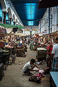 A butcher is seen skinning the skull of a buffalo in his shop at the century-old Sir Stuart Hogg Market, also known as the New Market in Kolkata, West Bengal  on Friday, May 26, 2017. Photographer: Sanjit Das