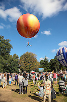 2016 09 18<br /> Pictured: Performer suspended from a giant peach. The Great Pyjama Picnic, Bute Park, Cardiff.Sunday 18 September 2016<br /> Re: Roald Dahl&Otilde;s City of the Unexpected has transformed Cardiff City Centre into a landmark celebration of Wales&Otilde; foremost storyteller, Roald Dahl, in the year which celebrates his centenary.
