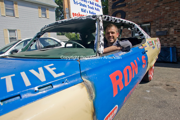 TORRINGTON, CT - 15 JUNE 2010 -061510JT02-<br /> Mike Leonard of Ron's Auto Shop in Torrington poses for a photo in an old Buick that he has prepared to use in this weekend's demolition derby at the Goshen Stampede on Tuesday.<br /> Josalee Thrift Republican-American