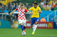 Luka Modric of Croatia and Paulinho of Brazil