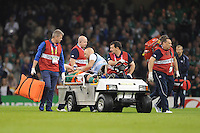 Paul O'Connell of Ireland inhales gas and air to relieve the pain as he is stretchered off at half time during Match 39 of the Rugby World Cup 2015 between France and Ireland - 11/10/2015 - Millennium Stadium, Cardiff<br />