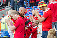 James Collins of Wales gives a young fan a shirt after striking a ball in his face ahead of the FIFA World Cup Qualifier match between Wales and Moldova at Cardiff City Stadium, Cardiff, Wales on 5 September 2016. Photo by Mark  Hawkins.