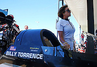 Sept. 21, 2013; Ennis, TX, USA: Kay Torrence stands alongside the NHRA top fuel dragster driven by husband Billy Torrence during the Fall Nationals at the Texas Motorplex. Mandatory Credit: Mark J. Rebilas-
