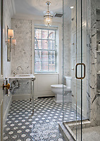 This custom bathroom features Honeycomb, a handmade mosaic shown in Calacatta Tia, Bardiglio and Ming Green from New Ravenna.<br />