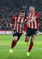 24th November 2019; Bramall Lane, Sheffield, Yorkshire, England; English Premier League Football, Sheffield United versus Manchester United; John Fleck  of Sheffield United celebrates with John Lundstram  of Sheffield United after he scores in the 19th minute to make it 1-0 - Strictly Editorial Use Only. No use with unauthorized audio, video, data, fixture lists, club/league logos or 'live' services. Online in-match use limited to 120 images, no video emulation. No use in betting, games or single club/league/player publications