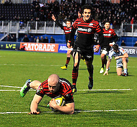 Hendon, England. James Short of Saracens scores a try  during the LV= Cup match for the first professional rugby game on the artificial turf pitch made for rugby between Saracens and Cardiff Blues at Allianz Park Stadium on January 27, 2013 in Hendon, England.