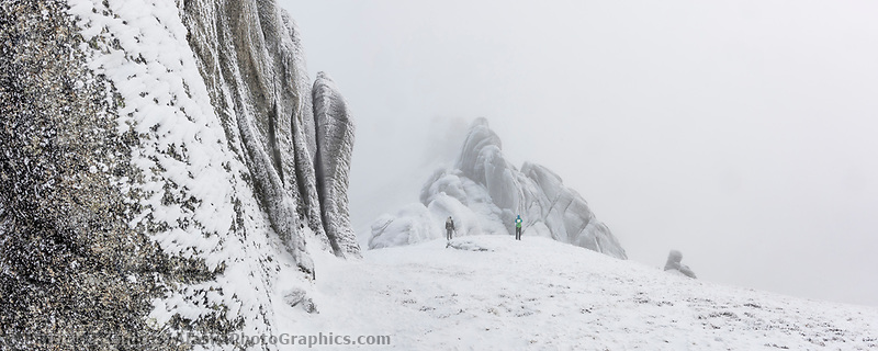 Two hikers traverse around the hoar frost covered granite tors along the ridge to Mt. Prindle, Steese National Conservation Area, Interior, Alaska.