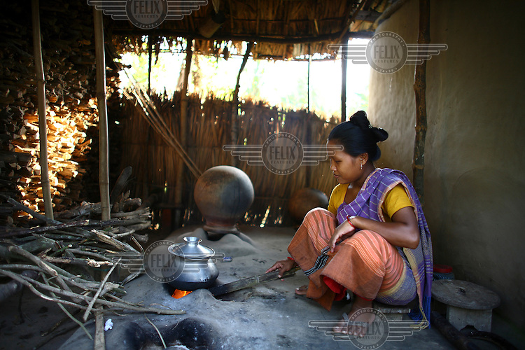 A Garo woman cooking. The Garo (or Mandi, as they refer to themselves) are an ethnic minority thought to be of Tibeto-Burmese origin. Prior to British rule they were mostly anamists but missionary work led the majority to convert to Christianity. The Garo of the Madhupur forest have long been under the threat of eviction by the government and the forest that they gain much of their livelihood from is being rapidly destroyed by unregulated logging.