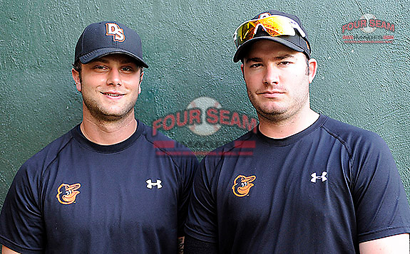 First baseman Christian Walker (23), left, and pitcher Matthew Price (25) of the Delmarva Shorebirds pose for a photo before a game against the Greenville Drive on Friday, April 26, 2013, at Fluor Field at the West End in Greenville, South Carolina. They were teammates for the National Champion University of South Carolina Gamecocks before being drafted. Delmarva won, 10-3. (Tom Priddy/Four Seam Images)