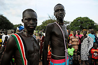 SOUTH SUDAN, Lakes State, village Mapourdit, Dinka celebrate harvest festival with dances, portraiture of two warriors, shawl with the colours of the south sudanese flag / SUED-SUDAN  Bahr el Ghazal region , Lakes State, Dorf Mapourdit , Dinka feiern ein Erntedankfest mit traditionellen Taenzen