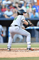 Augusta GreenJackets designated hitter Ryan Kirby (9) squares to bunt during a game against the Asheville Tourists at McCormick Field on June 15, 2018 in Asheville, North Carolina. The Tourists defeated the GreenJackets 6-5. (Tony Farlow/Four Seam Images)