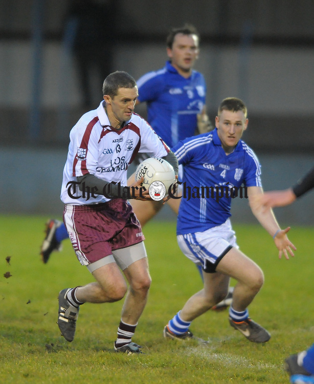 Kieran Considine of Liscannor in action against Enda Boyce of Cratloe during their senior championship game at Cooraclare. Photograph by John Kelly.