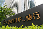 A signboard of Bank of Tokyo-Mitsubishi UFJ on display outside its building on May 17, 2017, Tokyo, Japan. Japan's biggest bank plans to shorten its name by dropping ''Tokyo'' to Bank of Mitsubishi UFJ. (Photo by Rodrigo Reyes Marin/AFLO)