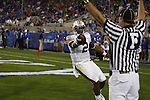 Quarterback Cam Newton asks for the touchdown call after scoring Auburn's first touchdown during the first half of UK's home game against Auburn, Oct. 9, 2010. Photo by Brandon Goodwin| Staff