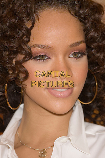RIHANNA.Launches new perfume at Selfridges Trafford Centre, Manchester, UK..November 28th, 2006.headshot portrait eyeliner hoop earrings.CAP/AT.©Alan Towse/Capital Pictures