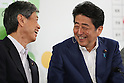July 10, 2016, Tokyo, Japan - Japanese Prime Minister and ruling Liberal Democratic Party (LDP) president Shinzo Abe (R) shares smiles with party's vice president Masahiko Komura before he pins a rosette on his party's candidates list in the Upper House election at the LDP headquarters in Tokyo on Sunday, July 10, 2016.    (Photo by Yoshio Tsunoda/AFLO) LWX -ytd-