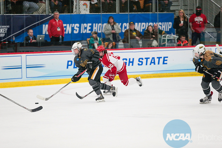 ADRIAN, MI - MARCH 18: Courtney Tyll (7) of Adrian College skates with th puck during the Division III Women's Ice Hockey Championship held at Arrington Ice Arena on March 19, 2017 in Adrian, Michigan. Plattsburgh State defeated Adrian 4-3 in overtime to repeat as national champions for the fourth consecutive year. by Tony Ding/NCAA Photos via Getty Images)