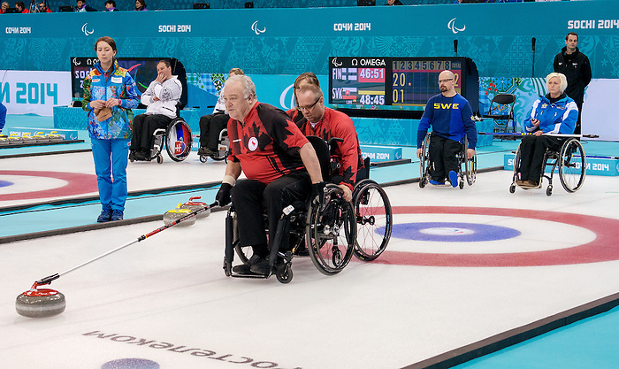 Sochi, RUSSIA - Mar 9 2014 -  Jim Armstrong and Dennis Thiessen playing against Sweden at the 2014 Paralympic Winter Games in Sochi, Russia.  (Photo: Matthew Murnaghan/Canadian Paralympic Committee)