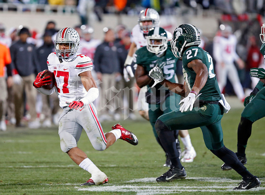 Ohio State Buckeyes running back Jalin Marshall (17) heads up field after catch against Michigan State Spartans during the 4th quarter at Spartan Stadium in East Lansing, Michigan on November 8, 2014.  (Dispatch photo by Kyle Robertson)