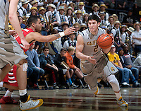 Sam Singer of California dribbles the ball during the game against Fresno State at Haas Pavilion in Berkeley, California on December 14th, 2013.  California defeated Fresno State, 67-56.