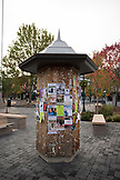 USA, Oregon, Ashland, cultural events are tacked up on a message board in the town square in downtown Ashland