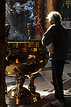 Bao-jhong Yi-min Temple, Kaohsiung -- A Taoist worshiper burning joss sticks.