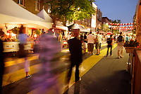 Montreal (QC) CANADA, 18 Juin 2010 -People walk at nigh on Sainte-Catherine while its transformed into a pedestrian street in the Gay Village for the summer
