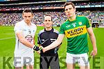 Eamon Callaghan, Kildare, Referee David McGoldrick and David Moran, Kerry before the All Ireland Quarter Final at Croke Park on Sunday.