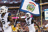 Landover, MD - SEPT 3, 2017: West Virginia Mountaineers wide receiver Gary Jennings (12)leads his team on the field before the game between West Virginia and Virginia Tech at FedEx Field in Landover, MD. (Photo by Phil Peters/Media Images International)