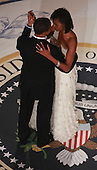 Washington, DC - January 20, 2009 -- United States President Barack Obama dances with First Lady Michelle Obama at the Commander-In-Chief's Inaugural Ball January 20, 2009 in Washington, DC.  Obama was sworn in as the 44th President of the United States, becoming the first African American to be elected President of the U.S. .Credit: Chip Somodevilla - Pool via CNP