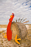 Red turkey made from hay roll, plywood and windmill windwheel along US 380 at the Luce Ranch, Caprock, New Mex.