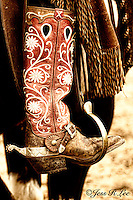 A close up photo of a cowgirls cowboy boots and spurs. Cowboys and cowgirls living the western lifestyle.