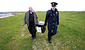 Presiding Officer Hugh O'Donnell and Garda Officer P.J. McHugh carry the ballot box to the island of Innishfree, County Donegal, Thursday, April 22, 2014 in the Irish Republic. The local home of Phil Currid was turned into a temporary Polling Station where Islanders Phil and Hans Schleweck formley of Stuttgart, Germany, cast their vote on the Donegal Island of Innishfree. The rest of Ireland will cast their votes tomorrow Friday May 23rd. A total of 2,131 people are registered to vote on 12 islands. In Donegal, where there are five islands, 753 people are entitled to vote. Photo/Paul McErlane