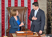 Former Speaker of the United States House of Representatives and current US House Minority Leader Nancy Pelosi (Democrat of California), left, welcomes incoming Speaker of the US House of Representatives Paul Ryan (Republican of Wisconsin), right, to the podium as Ryan assumes his duties of the office in the US House Chamber in the US Capitol in Washington, DC on Thursday, October 29, 2015.<br /> Credit: Ron Sachs / CNP