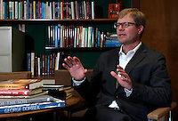 NWA Media/DAVID GOTTSCHALK - 12/19/14 - Mike Bieker, the director of the University of Arkansas Press, in his office Friday December 19, 2014 on the campus in Fayetteville.