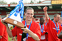 David Bridges of Stevenage Borough celebrate with the Blue Square Premier championship trophy after the Blue Square Premier match between Stevenage Borough and York City at the Lamex Stadium, Broadhall Way, Stevenage on Saturday 24th April, 2010..© Kevin Coleman 2010 ..