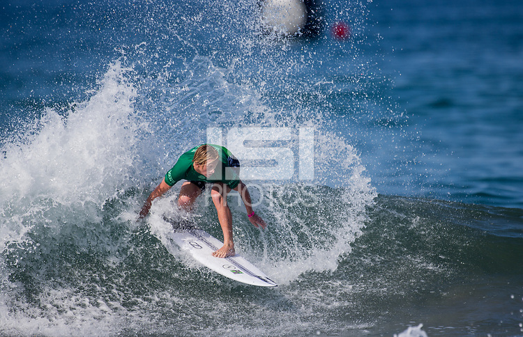 Huntington Beach, CA - Tuesday July 31, 2018: Finn McGill in action during a World Surf League (WSL) Qualifying Series (QS) Men's round of 96 heat at the 2018 Vans U.S. Open of Surfing on South side of the Huntington Beach pier.